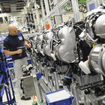 Image: VVolkswagen employee works on a diesel engine