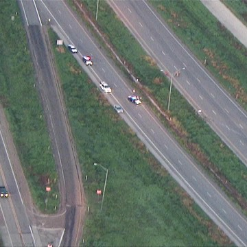 Image: Police are investigating after an SUV carrying 15 passengers flipped on a highway in Edna