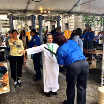 Image: A nun being checked by a TSA agent in Philadelphia early Saturday.
