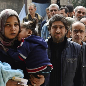 Image: Residents of the Yarmouk refugee camp in Damascus, Syria