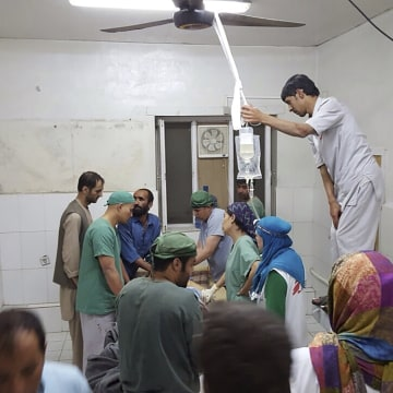 Image: Afghan (MSF) surgeons work inside a Medecins Sans Frontieres (MSF) hospital