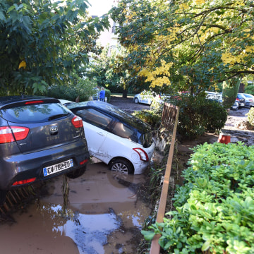 Image: Damaged cars are seen in a parking lot in Mandelieu-la-Napoul