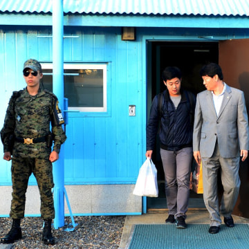 Image: Joo Won-moon, who had been a student at New York University, arrives at the truce village of Panmunjom in the demilitarised zone (DMZ) separating the two Koreas