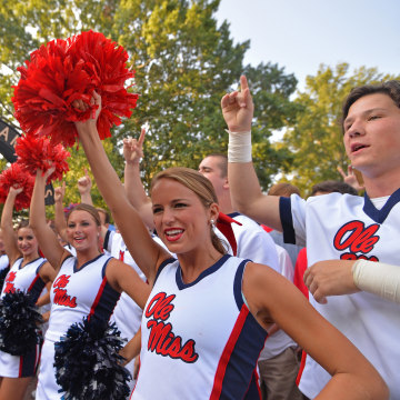 Image: University of Mississippi cheerleaders cheer before a football game
