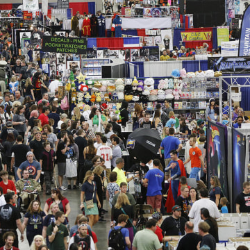 IMAGE: Numerous attendees walk through Salt Lake Comic Con 2015