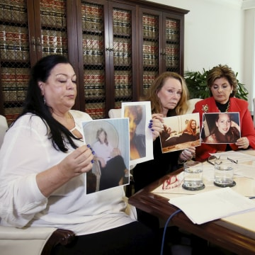 Image: Pamela Abeyta, Sharon Van Ert, and Lisa Christie, who allege misconduct by Bill Cosby, hold up photos of themselves from a younger age, during a press conference with attorney Gloria Allred at her law office in Los Angeles