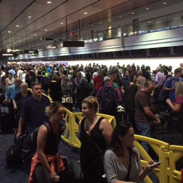 IMAGE: Delayed passengers at the Las Vegas airport