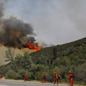 Image: Inmate Firefighters stand along Highway 20 during the Rocky Fire near Lower Lake, California