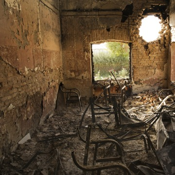 Image: A hole in a wall from a shell at the Doctors Without Borders hospital in Kunduz, Afghanistan