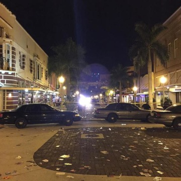 Image: Police patrol cars stand in Fort Myers