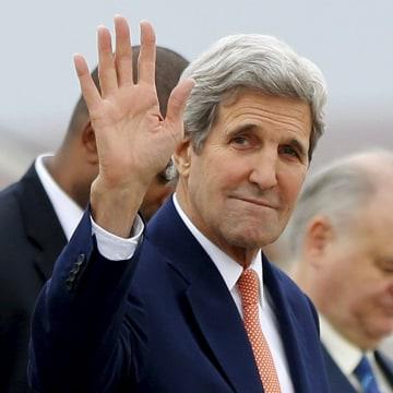 Image: U.S. Secretary of State John Kerry waves after arriving at Torrejon air base