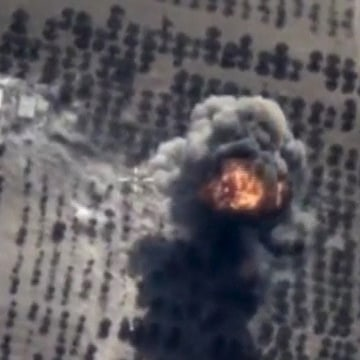Image: Frame grab taken from Russia's Defence Ministry footage shows explosion after airstrikes carried out by Russian air force in Idlib province, Syria