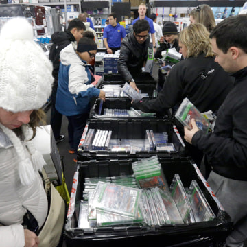 Image: Shoppers sift through video games at a Best Buy
