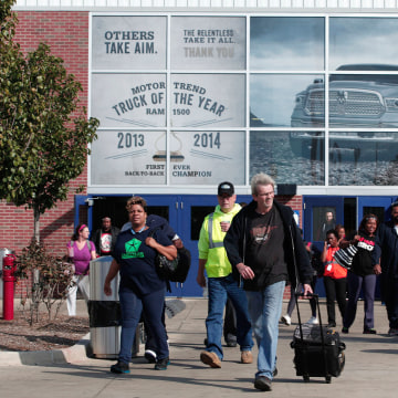 Image:  Fiat Chrysler Automobile (FCA) workers exit from the Warren Truck Assembly Plant
