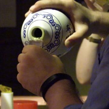 Image: Florida bartender David Putney pours baijiu intro a traditional glass