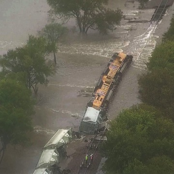Image: A train overturned in floodwaters in Navarro County, Texas.