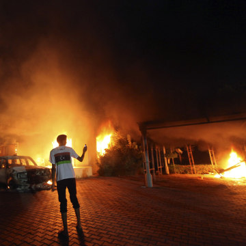 Image: The U.S. Consulate in Benghazi is seen in flames on Sept. 11, 2012.