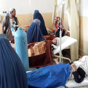 Image: Afghan school girls are treated at a hospital after an earthquake in Takhar province