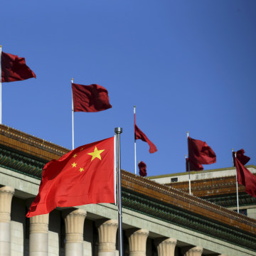 Image: Chinese flag waves in front of the Great Hall of the People in Beijing