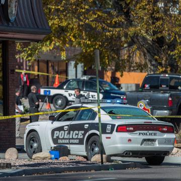 Image: The rear window of a Colorado Springs Police car