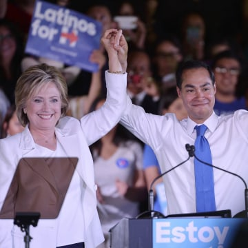 "Image: Democratic U.S. presidential candidate Clinton holds the hand of HUD Secretary Castro after he endorsed her at a ""Latinos for Hillary"" rally in San Antonio, Texas"