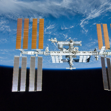 Image: The International Space Station orbits around Earth in 2010.
