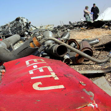 Image: Egyptian officials inspect the crash site