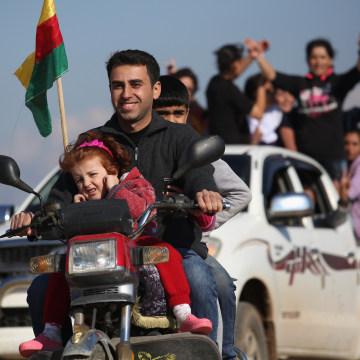 Image: Yazidi refugees in Syria celebrate