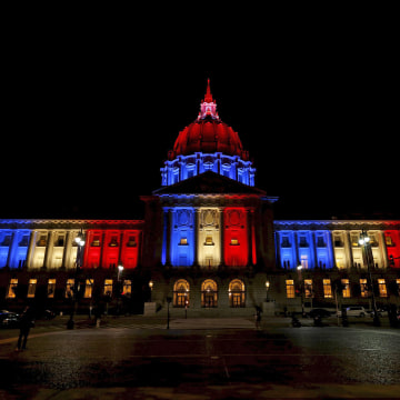 Image: San Francisco City Hall is lit up with blue, white and red, the colors of the French flag, following the Paris terror attacks, in San Francisco