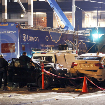 Image: Investigators survey the scene of an accident after a tour bus crashed into multiple vehicles in San Francisco, California