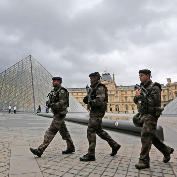 Image: Soldiers patrol in the courtyard of the Louvre Museum