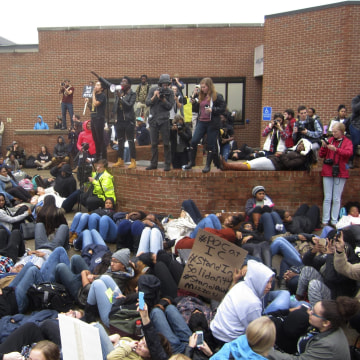 Image: Leaders from the group People of Color encourage students to lay down as part of a die-in this afternoon at Ithaca College in Ithaca, New York