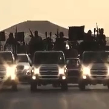 Image: Alleged ISIS extremists riding trucks