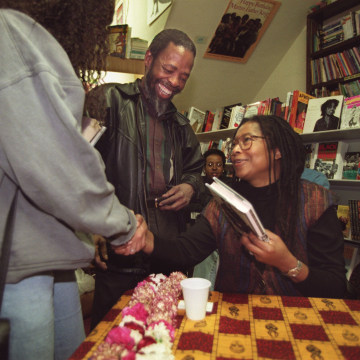 Author Alice Walker (seated with glasses) signs books at Eso Won Books in Inglewood. Walker's new bo
