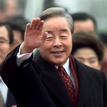 Image: File photo of South Korean President Kim Young-sam waving after arriving in Vancouver for the APEC Summit