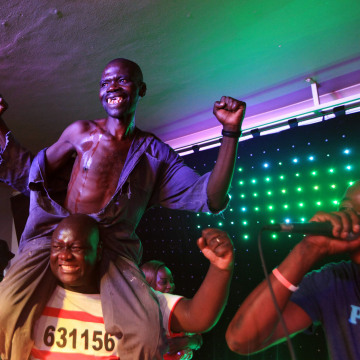 Image: Mison Sere reacts after winning the 2015 edition of the Mr Ugly competition