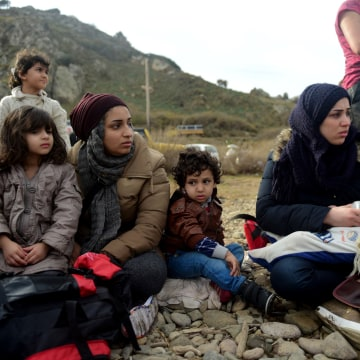 Image: Migrants and refugees arrive on the Greek island of Lesbos