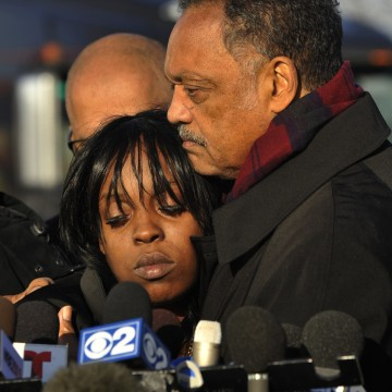 Image: Rev. Jesse Jackson, right, comforts Laquan McDonald's aunt Tanisha Hunter