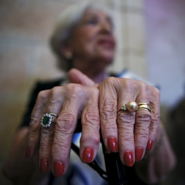 Image: Rivka Kushnir, a Holocaust survivor, waits backstage during a beauty contest for survivors of the Nazi genocide in Haifa