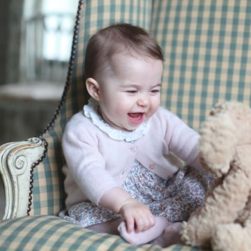 Image: Princess Charlotte playing with a toy dog.