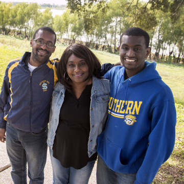 Image: Brothers Micah and Josiah Frank pose for a photo with their mother Latonzia Montgomery on the Southern University campus in Baton Rouge, Louisiana.