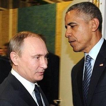 Image: Vladimir Putin shakes hands with Barack Obama.