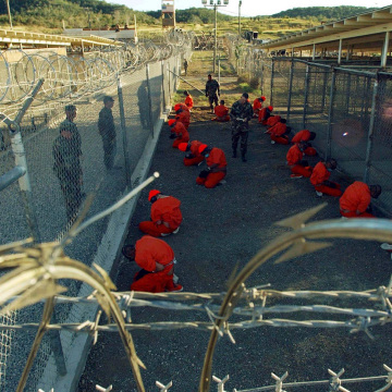 Image: Detainees in orange jumpsuits at Guantanamo Bay