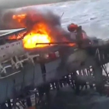 Image: A still image from a video footage shows an oil platform on fire in the Caspian Sea