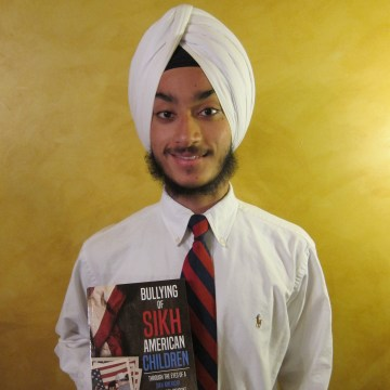 """New Jersey high school student Karanveer Singh Pannu with his new book, """"Bullying of Sikh American Children: Through the Eyes of a Sikh American High School Student"""""""