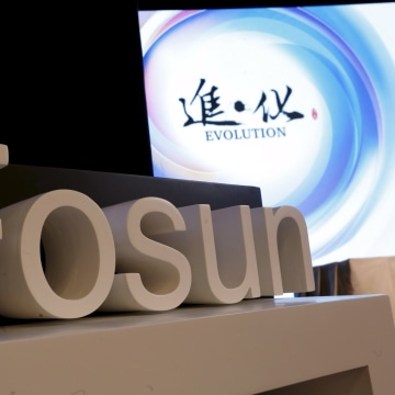 Image: File photo of a company logo of Fosun International at the annual general meeting of the Chinese conglomerate in Hong Kong