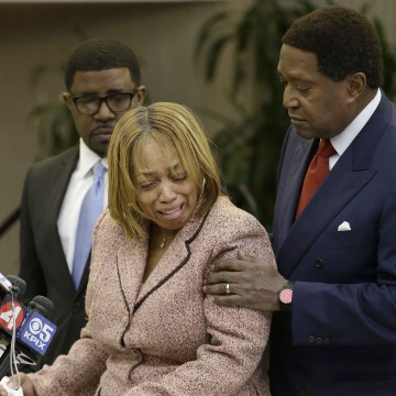 Image: Gwen Woods is comforted by her attorney