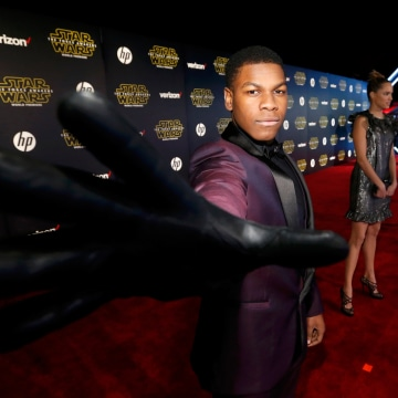 """Image: Actor John Boyega arrives at the premiere of """"Star Wars: The Force Awakens"""" in Hollywood"""
