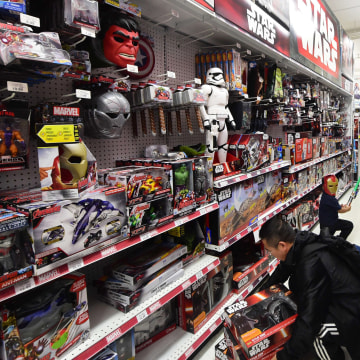 Image: People shop for items at a store selling Star Wars merchandise