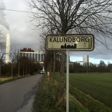 Image: A car drives in front of DONG Energy's power station in Kalundborg